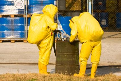 People in Yellow Suits Collecting Hazardous Material