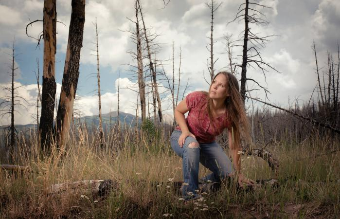 Woman in a Burnt Forest
