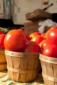 red tomatoes in baskets