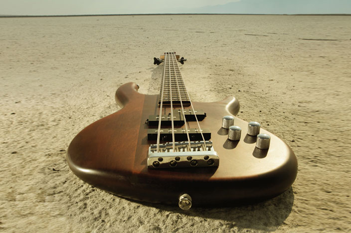 Bass-guitar-on-sand.jpg