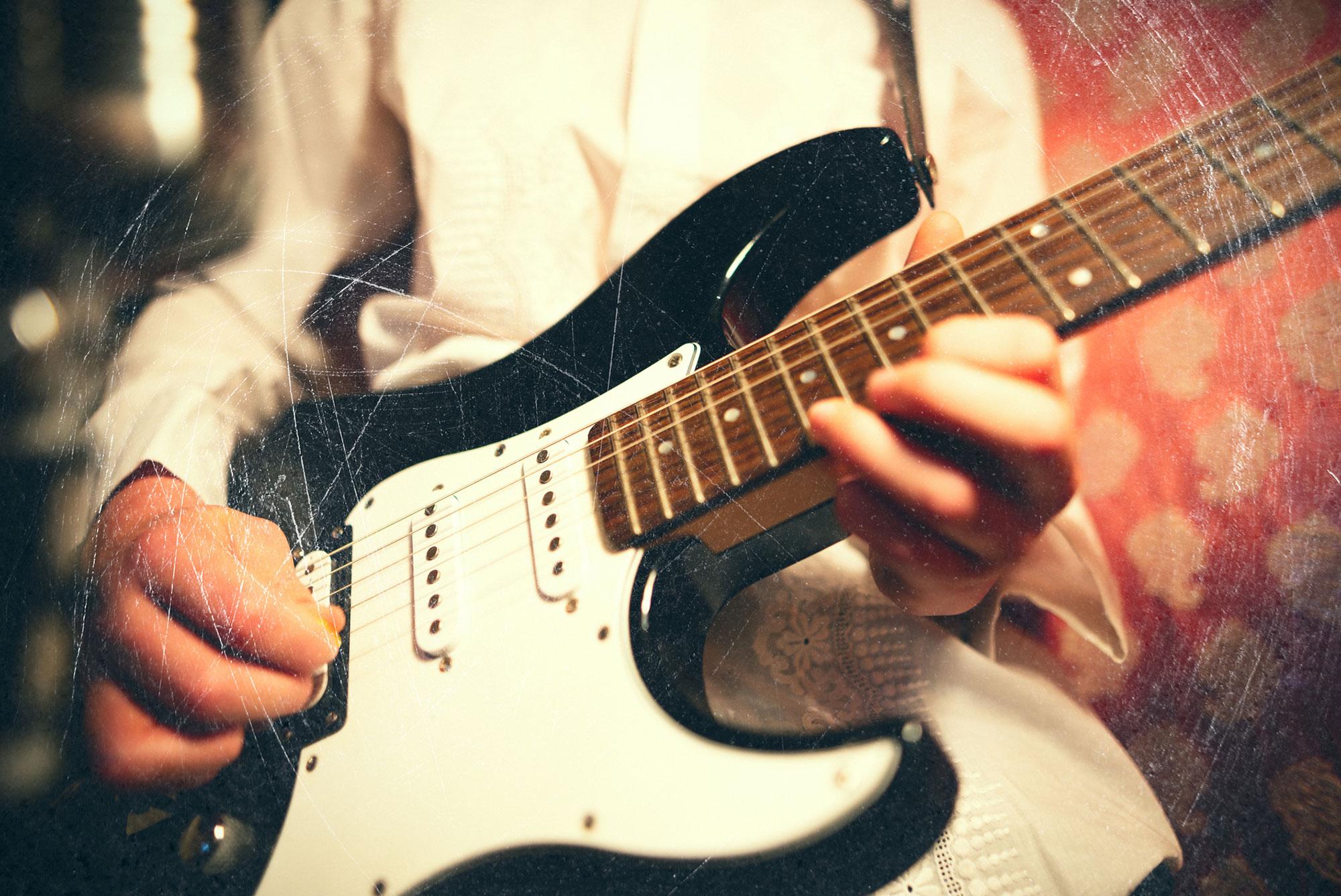 closeup-man-playing-guitar.jpg