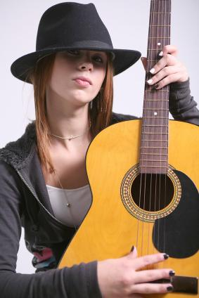 Woman holding an acoustic guitar