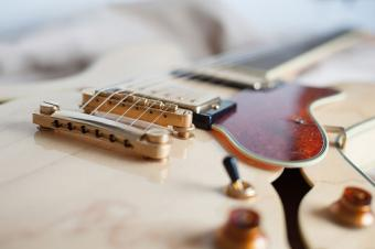 Guitar bridge where strings are attached