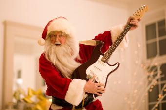 Santa rocking an electric guitar