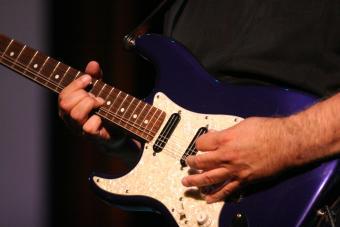 Closeup of lefty playing electric guitar
