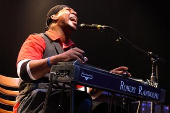 Robert Randolph playing pedal steel guitar; © Aphotogroove | Dreamstime.com