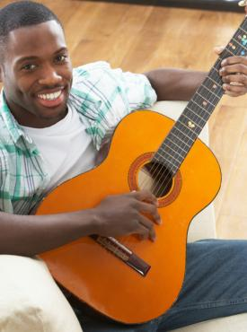 Happy beginner playing guitar