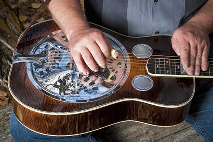 Man playing steel guitar