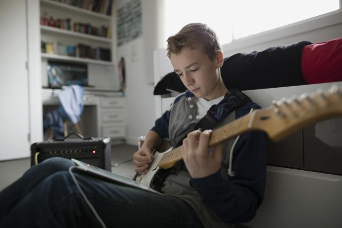 Boy playing electric guitar