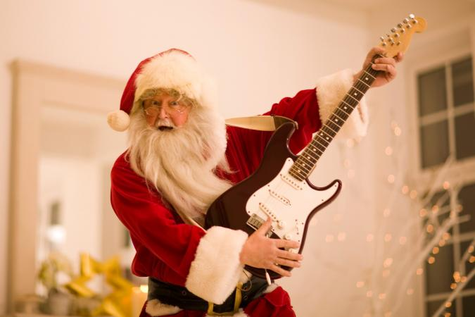 Santa rocking an electric guitar