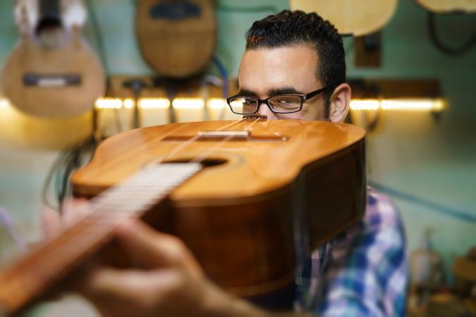 appraising acoustic guitar