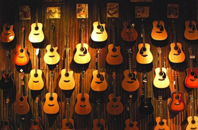 Acoustic guitars on a wall
