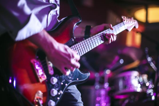 guitarist playing in a concert