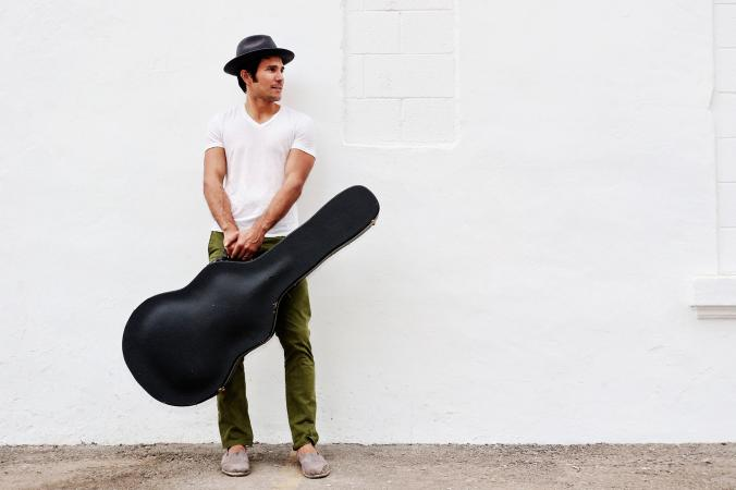 Man holding a black guitar case