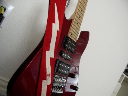 cool guitar straps lovetoknow. Black Bedroom Furniture Sets. Home Design Ideas