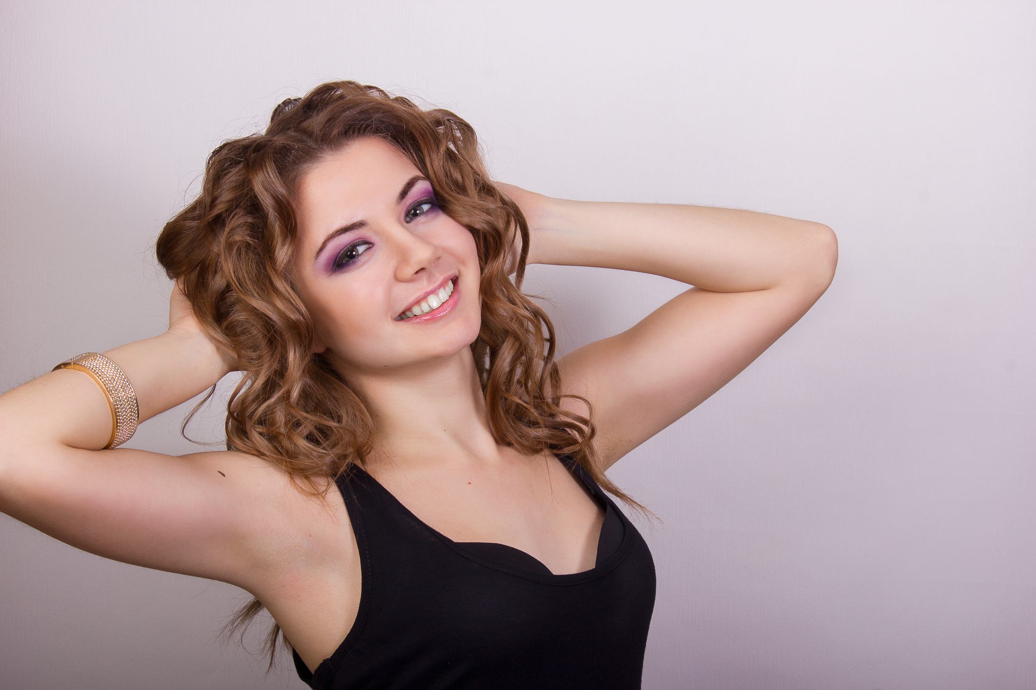 iStock-469672395-Beautiful-young-girl-with-brown-curly-hair.jpg