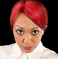 Woman with hair dyed bright red