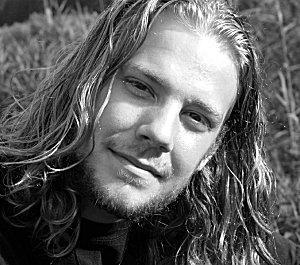 man with long hippy hair