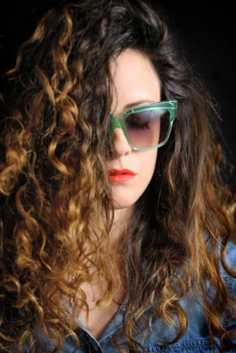 Woman with thick rocker curls hairstyle