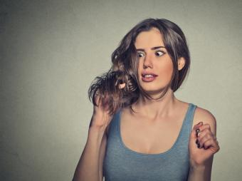 Woman frustrated with new hair cut