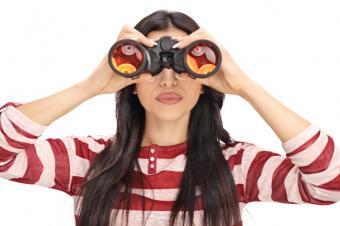 Woman looking through binoculars