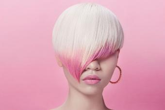 https://cf.ltkcdn.net/hair/images/slide/209536-850x567-Blond-and-pink-style-partially-covering-face.jpg