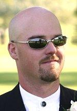 Man with mustache, goatee and shaved head