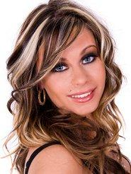 Woman with highlighted, wavy hair