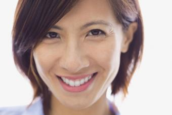 Smiling woman with hair parted on side