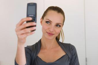 Woman hair pulled back taking selfie