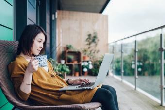 woman designing virtual hairstyle on laptop