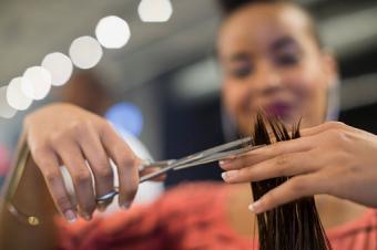 hairstylist cutting hair in hair salon