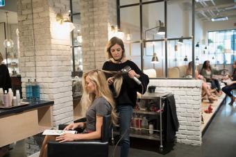 hairstylist with customer in hair salon
