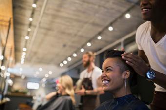 Hairstylist styling hair in hair salon