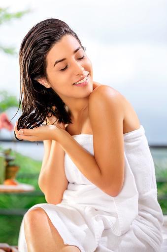 woman doing self hair treatment