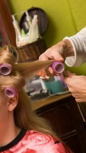Image of fine hair being rolled in curlers
