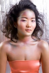 Image of Asian woman with wavy hairstyle