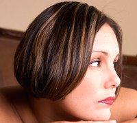 Dark-haired woman with bleached highlights