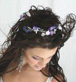 Bride wearing a floral wreath hair piece