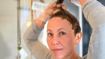 Woman dyeing her brunette hair