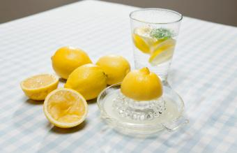 Lemons juicer and glass of water