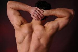 Muscular man with a smooth waxed back