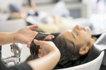 Relaxed Customers getting a hair washed by beautician at the beauty salon