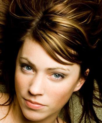 Blonde highlights add interest to brown hair.