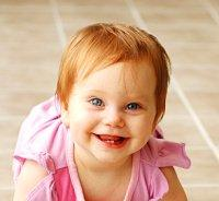 Baby with light red hair