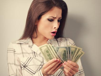 Woman looking at money