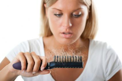 woman shedding hair