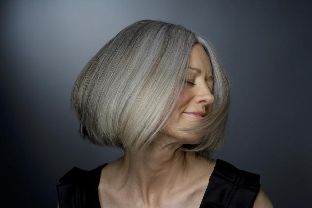 Mature woman turning head