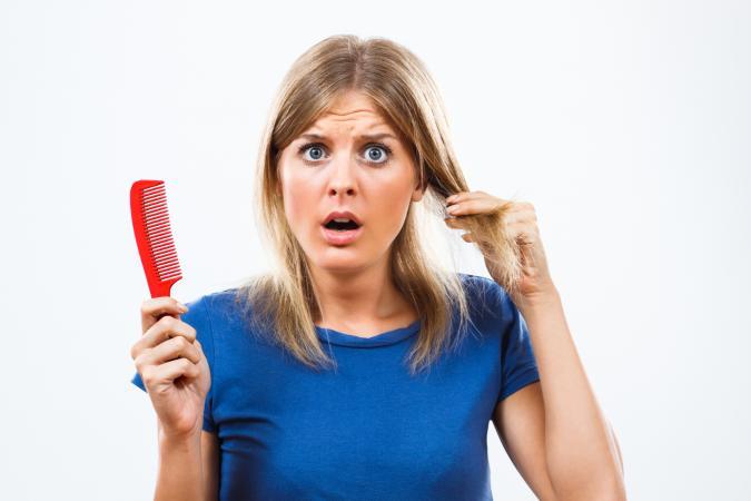 woman losing her hair