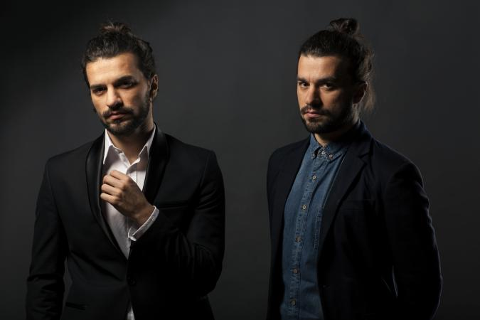 Handsome young men with man buns